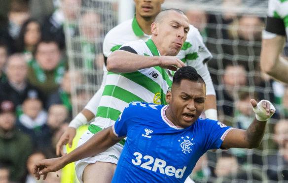 Celtic's Scott Brown tackles Rangers' Alfredo Morelos