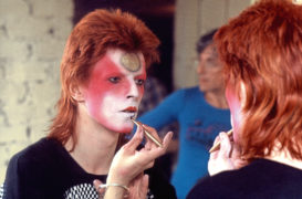 David Bowie applying his alter-ego make-up in 1973