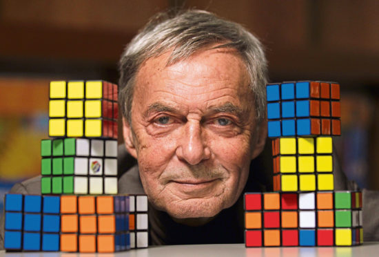 Erno Rubik with his famous invention