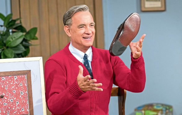 Tom Hanks stars as puppeteer, producer, Presbyterian minister and US television personality Fred Rogers