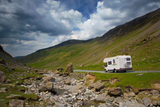 A driver stops to take in the view at the Honister Pass in the Lake District
