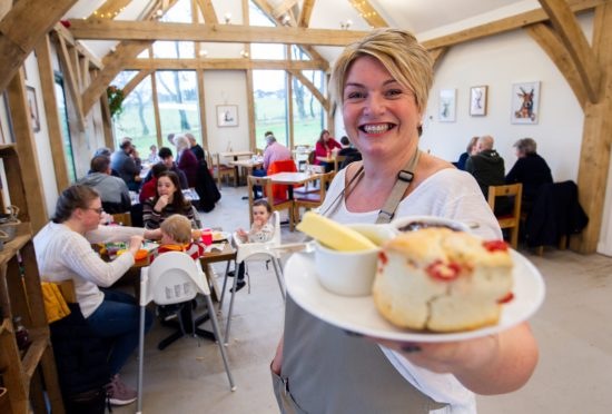 The fruit scone at The Heron Farm Shop & Kitchen is large, light and sweet with a decent amount of juicy fruit inside
