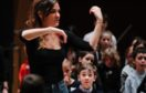 A young musician looks impressed as Nicola Benedetti offers expert tuition