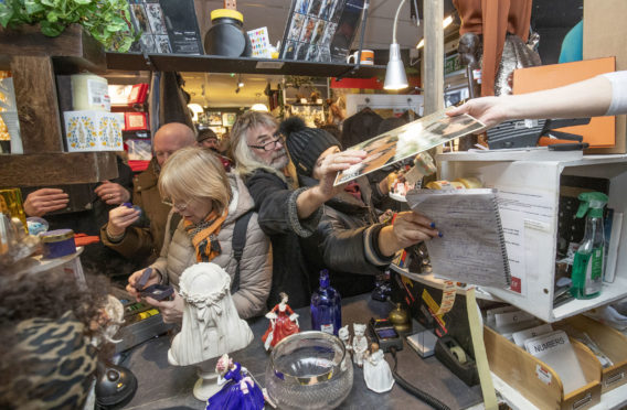 Shoppers snap up top brands at the launch of the designer sale at Shelter Scotland's shop in Stockbridge, Edinburgh, on Friday