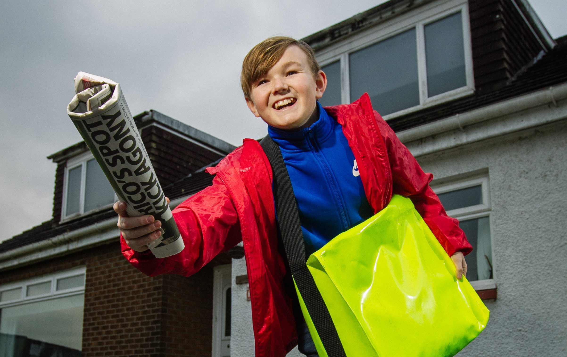 Paperboy Arryn Embleton, 12, delivering the news to neighbours in Alexandria
