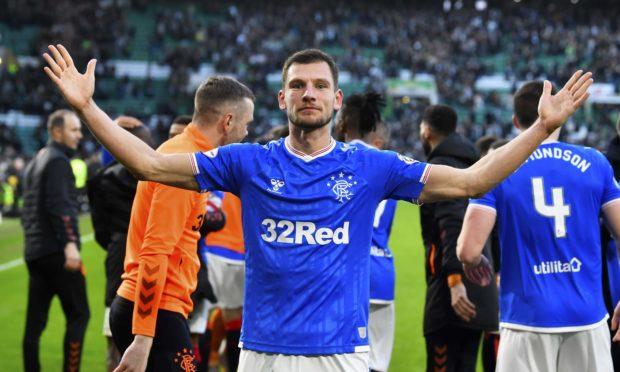 Borna Barisic celebrates  after Rangers beat Celtic