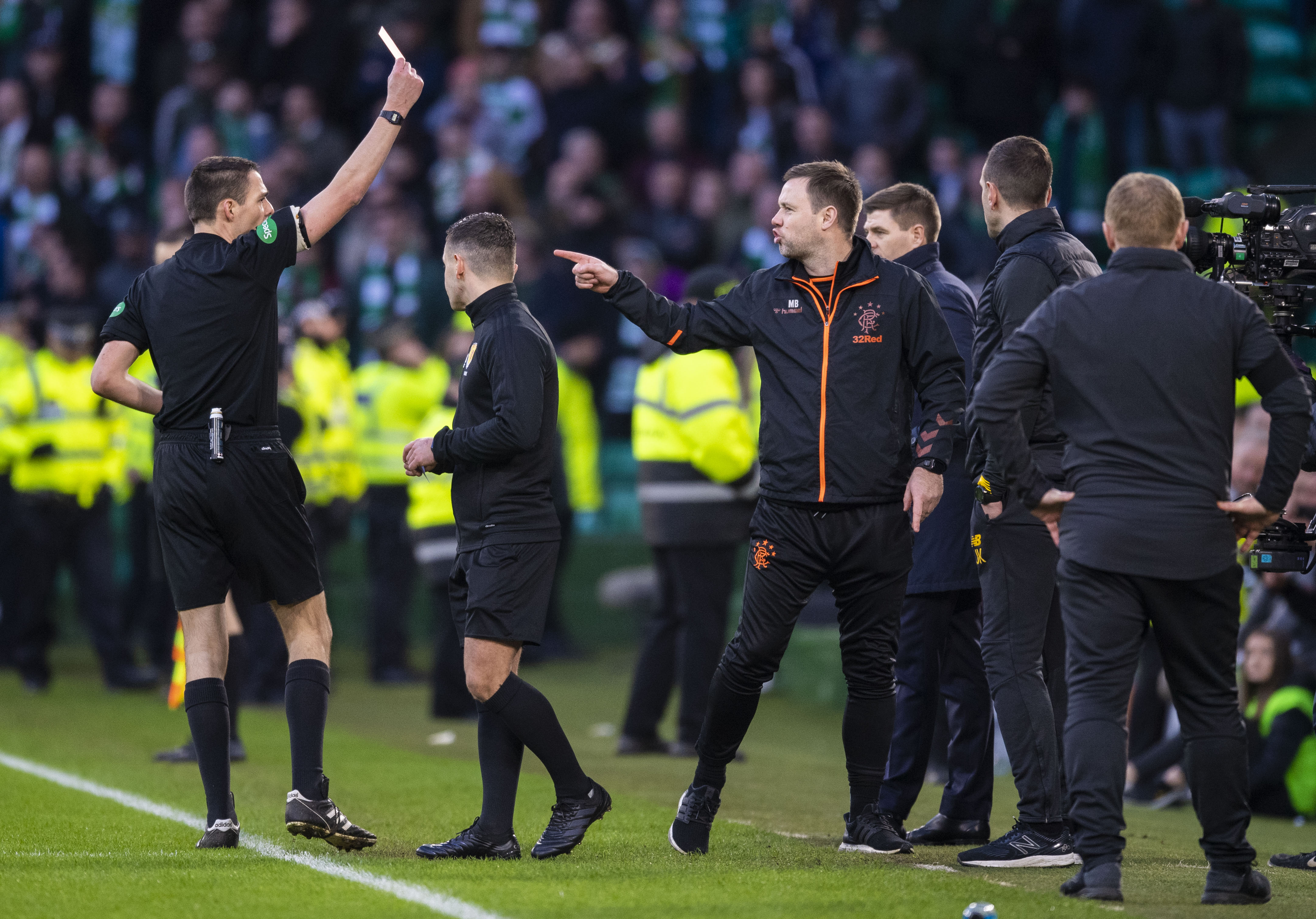 Referee Kevin Clancy sends off first team coach Michael Beale (right) during match between Celtic and Rangers