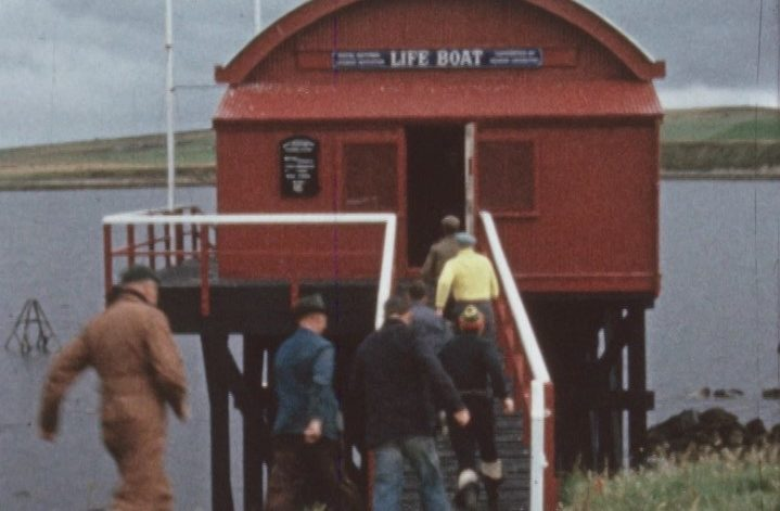 The Longhope crew rush to the lifeboat in 1964