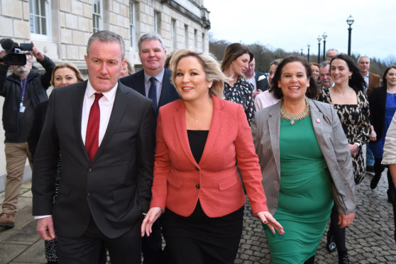 Northern Ireland's new Deputy First Minister Michelle O'Neill, centre, arrives at Stormont with Conor Murphy and Mary Lou McDonald
