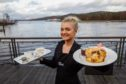 Waitress Catherine, in front of Loch Lomond and the Maid of the Loch paddle steamer, shows off Café Zest's fare