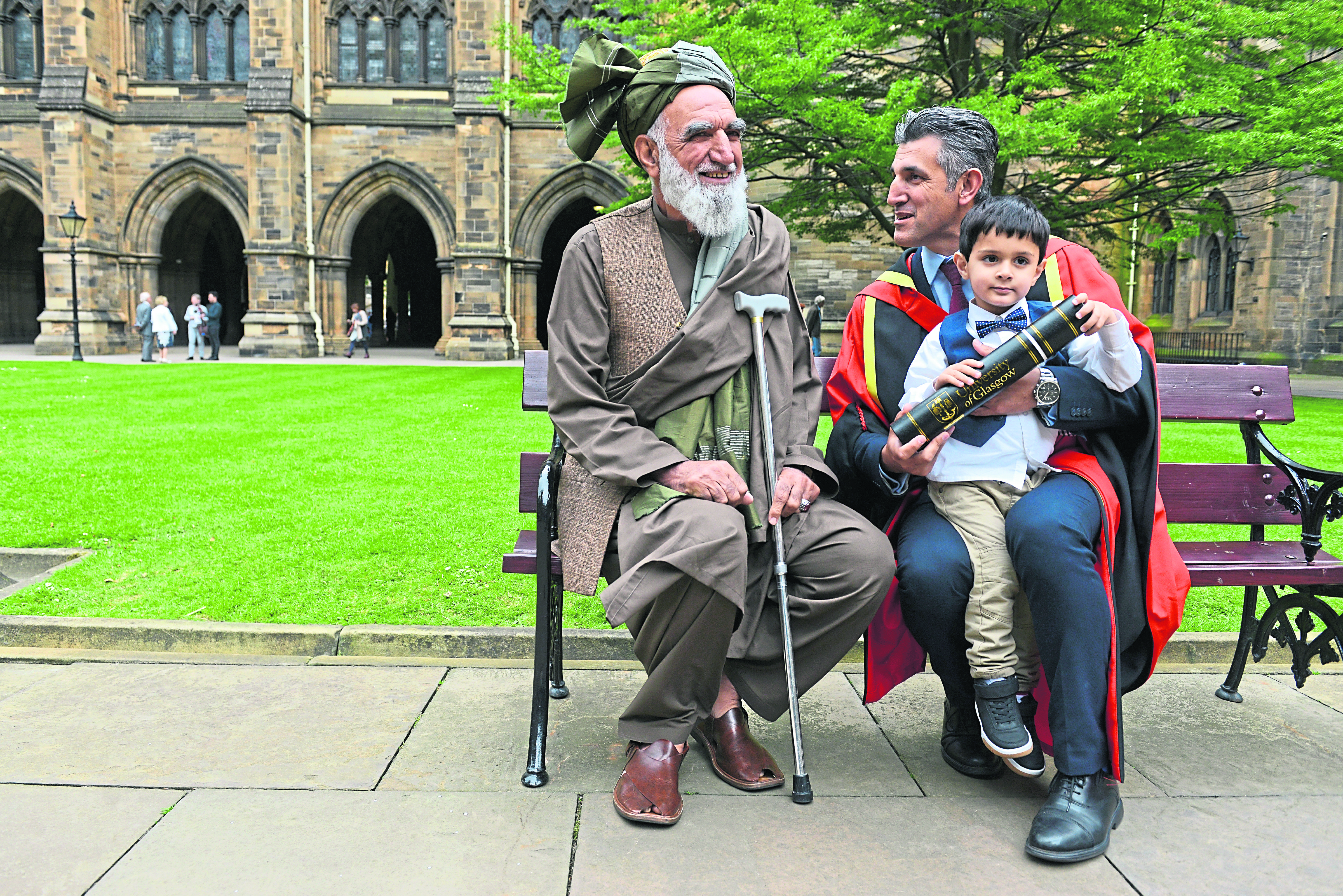 The special moment the head of the Scottish Refugee Council collected his honorary doctorate in front of his father despite him previously being denied entry to the UK.