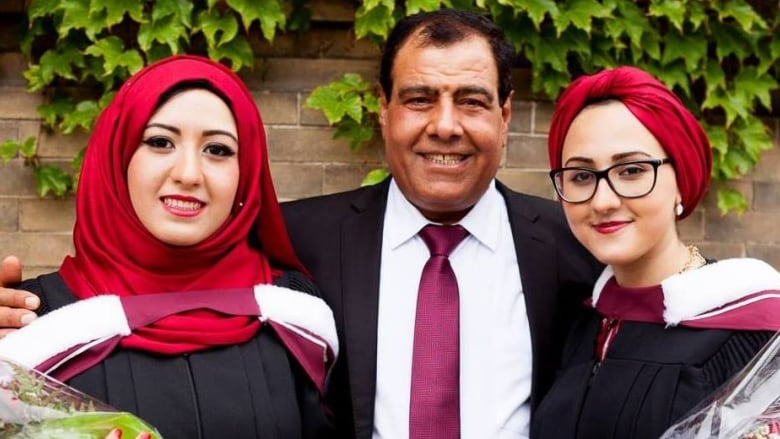 Abuelaish with his surviving daughters Dalal and Shatha