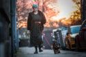 Tuesday Mennie walking her dog Hamish