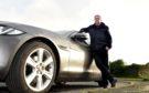 Bruce Collie beside his Jaguar XE