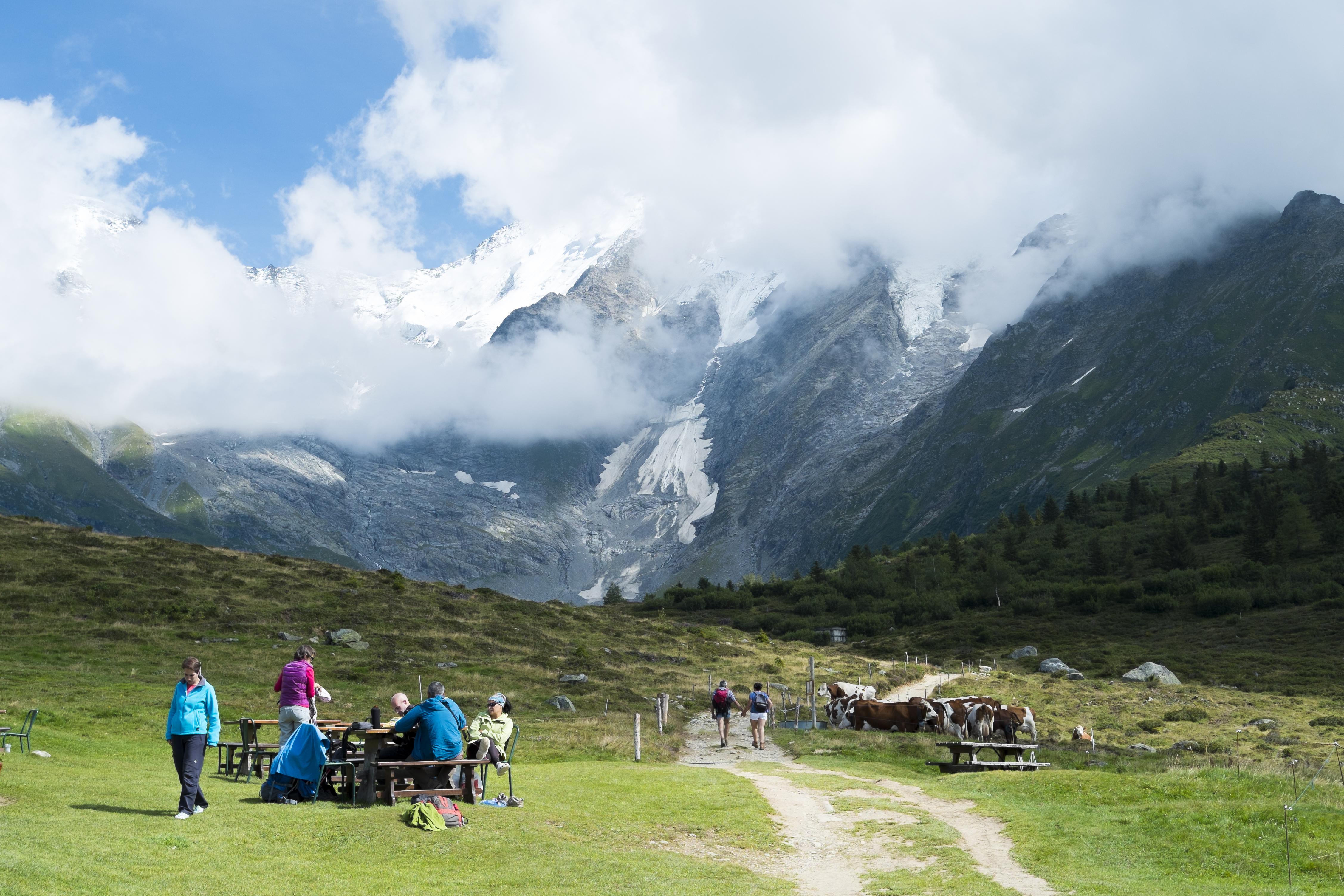 Mont Blanc tour hikers enjoy a break in beautiful surroundings