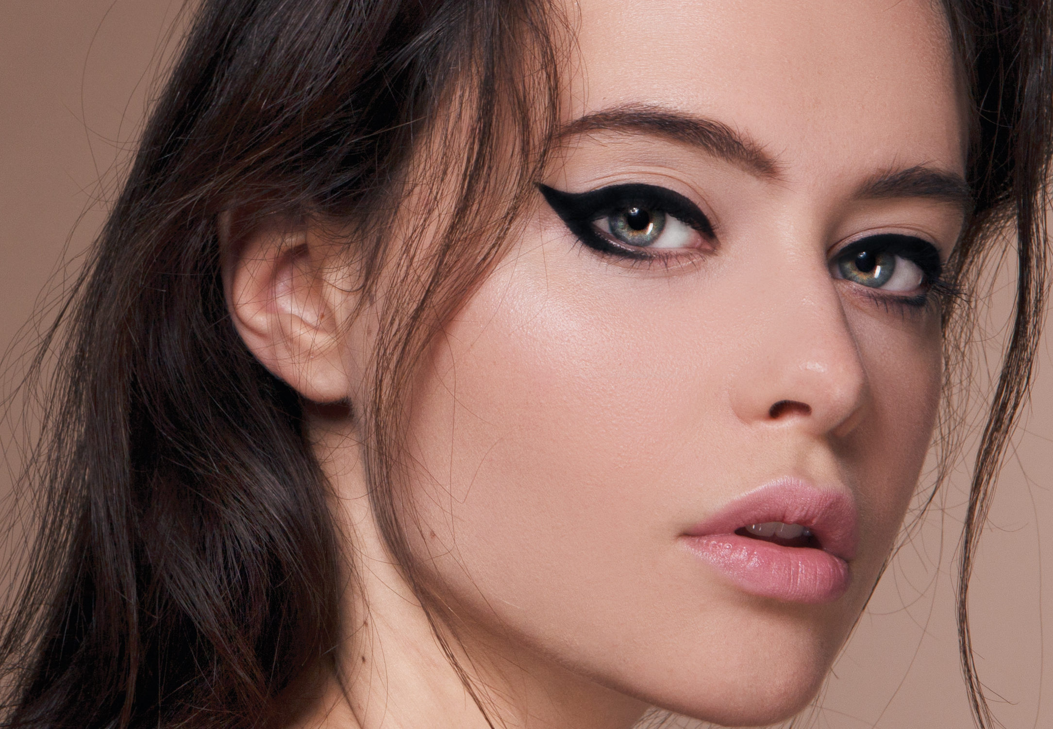 The iconic eyeliner flick is ideal for framing your eyes