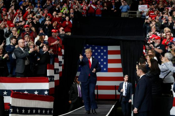 President Donald Trump arrives to speak at a campaign rally, in Toledo, Ohio
