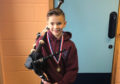 James Macrae, 9, with a set of loaned pipes