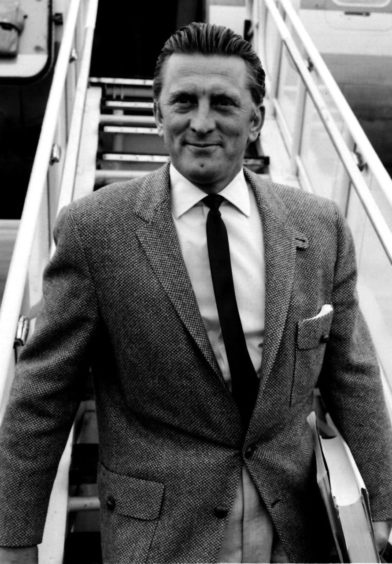 The 1950s saw Douglas star in Ace in the Hole, Paths of Glory and other Hollywood classics. Here, Douglas is back in London in 1958 to play the role of Dick Dudgeon in the film version of the George Bernard Shaw play The Devil's Disciple