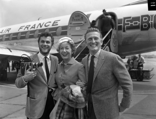 Kirk Douglas's first foray into cinema came in 1946 when he secured a role in The Strange Love of Martha Ivers. Here, he and his wife Anne Buydens are pictured arriving in London in 1957 for a costume fitting for The Vikings
