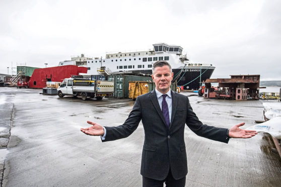 Derek Mackay poses inside Ferguson's after being nationalised by Scottish Government in August