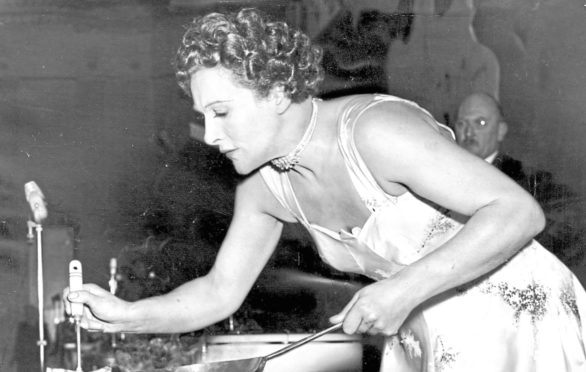 Fanny cooking in satin at the Cafe Royal in 1956
