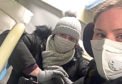 Jodi Carr and mum Alison wear masks on the train from Tianjin to Shanghai