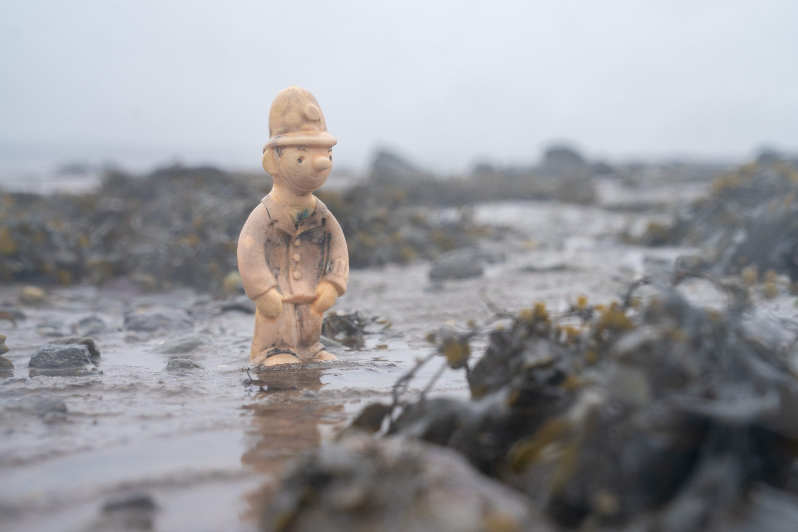 The plastic figure of Camberwick Green's PC McGarry on the beach at Torryburn after being in the sea for decades
