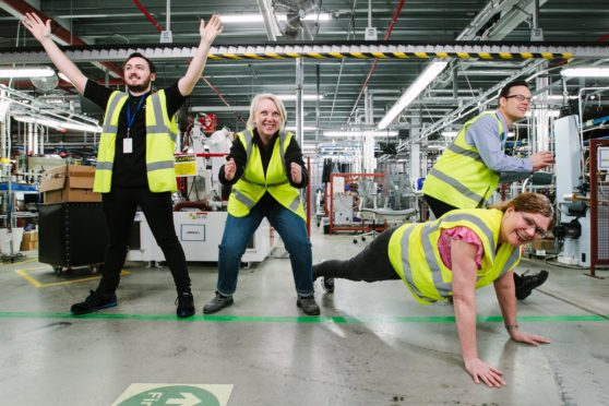 Connor Keane, Izabela Kirszke, Jan Buntin and Andrew MacFarlane of ACS Clothing work out in the company's factory at Eurocentral near Motherwell