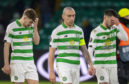 Celtic's James Forrest, Scott Brown and Greg Taylor trudge off after defeat to Copenhagen