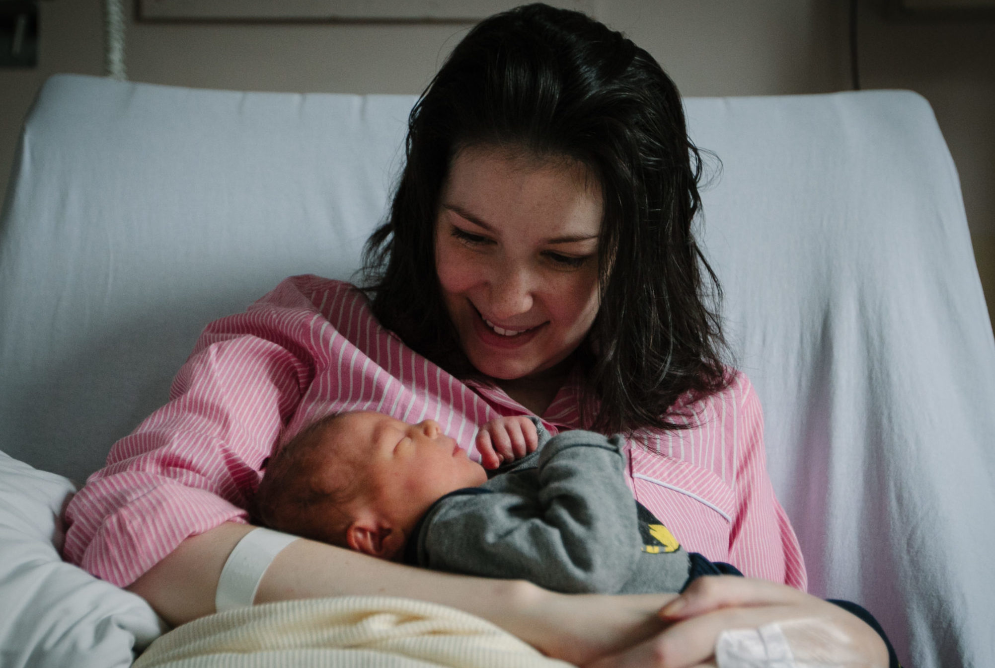Brave new mum Lucy Lintott cuddles little son LJ in maternity ward