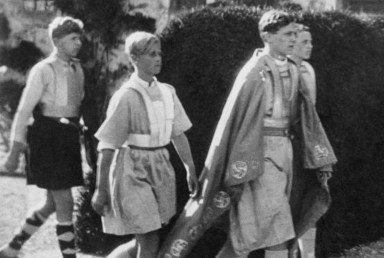 12-year-old Prince Philip, second left,  takes part in a pageant at Gordonstoun School in Moray in 1933