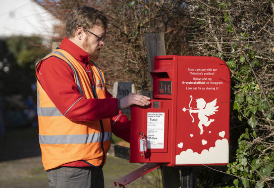 A specially designed Royal Mail post box is unveiled in Lover, Wiltshire