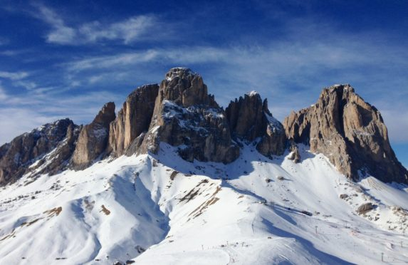 The spectacular jagged peaks of the Dolomites tower over so many fantastic ski runs