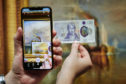 The new 20 pound note with a new Snapchat augmented reality (AR) Lens in front of the original JMW Turner masterpiece The Fighting Temeraire at The National Gallery in London