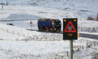 Snow and Ice warnings on the A835 Inverness to Ullapool road earlier this year