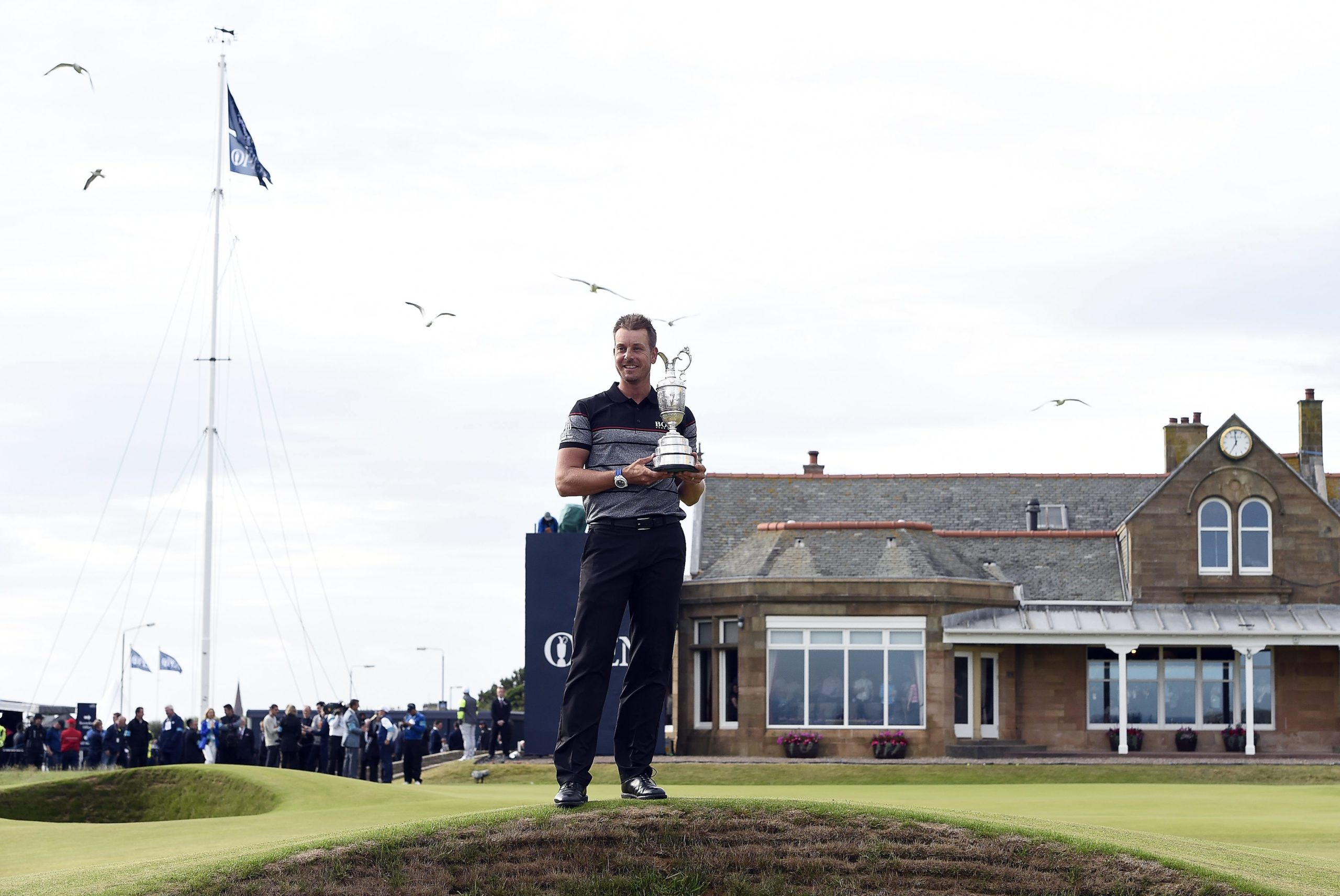 Henrik Stenson holds the Claret Jug after winning The 2016 Open in Troon