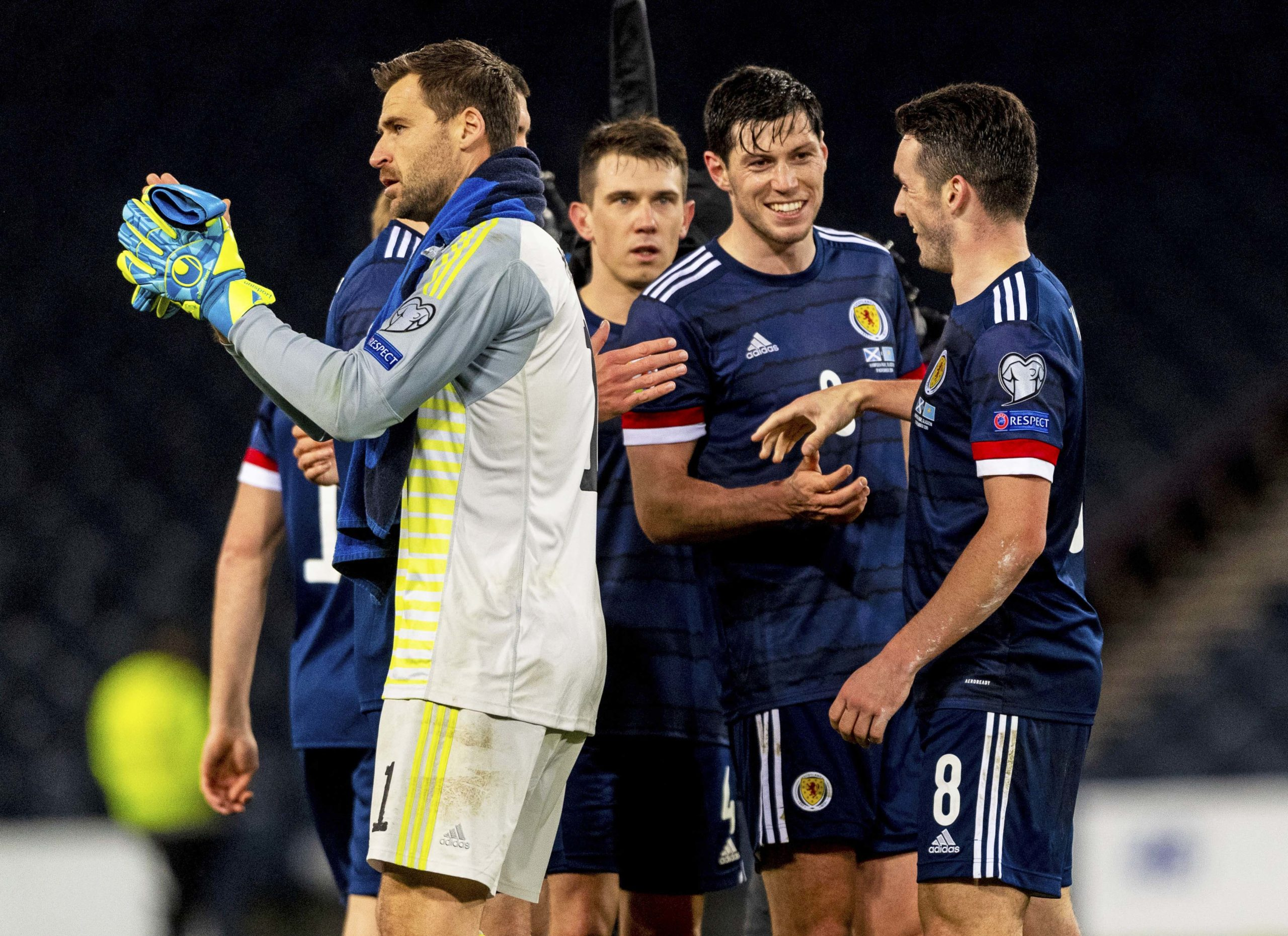 David Marshall and his Scotland team-mates applaud the Tartan Army after the win over Kazakhstan in November