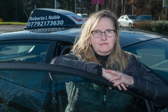 Driving instructor Roberta Noble with her new car in Aberdeen