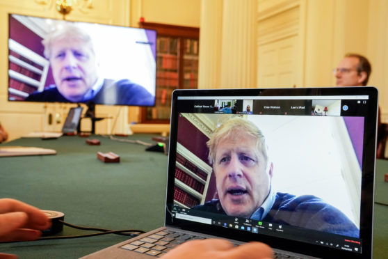 Boris Johnson chairs a Covid-19 meeting via video call