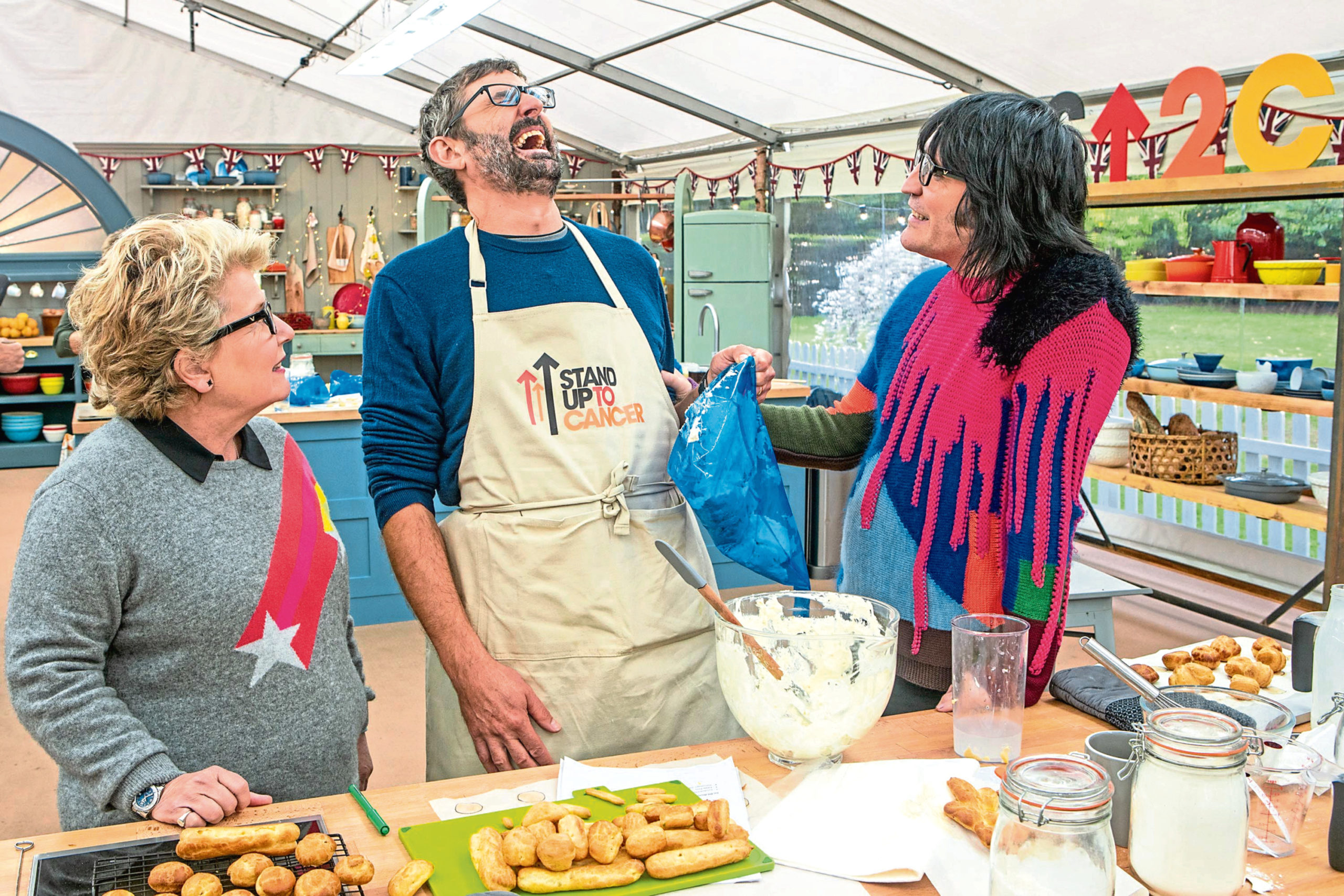 Louis Theroux, centre, with Bake Off hosts Sandi Toksvig and Noel Fielding