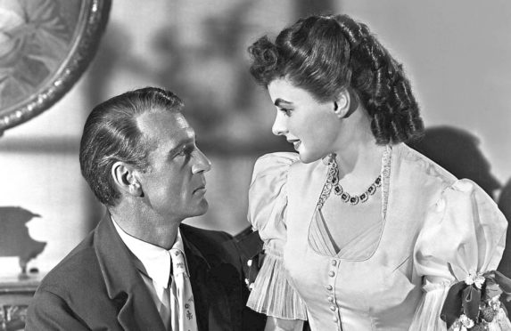 Gary Cooper alongside Ingrid Bergman in Saratoga Trunk