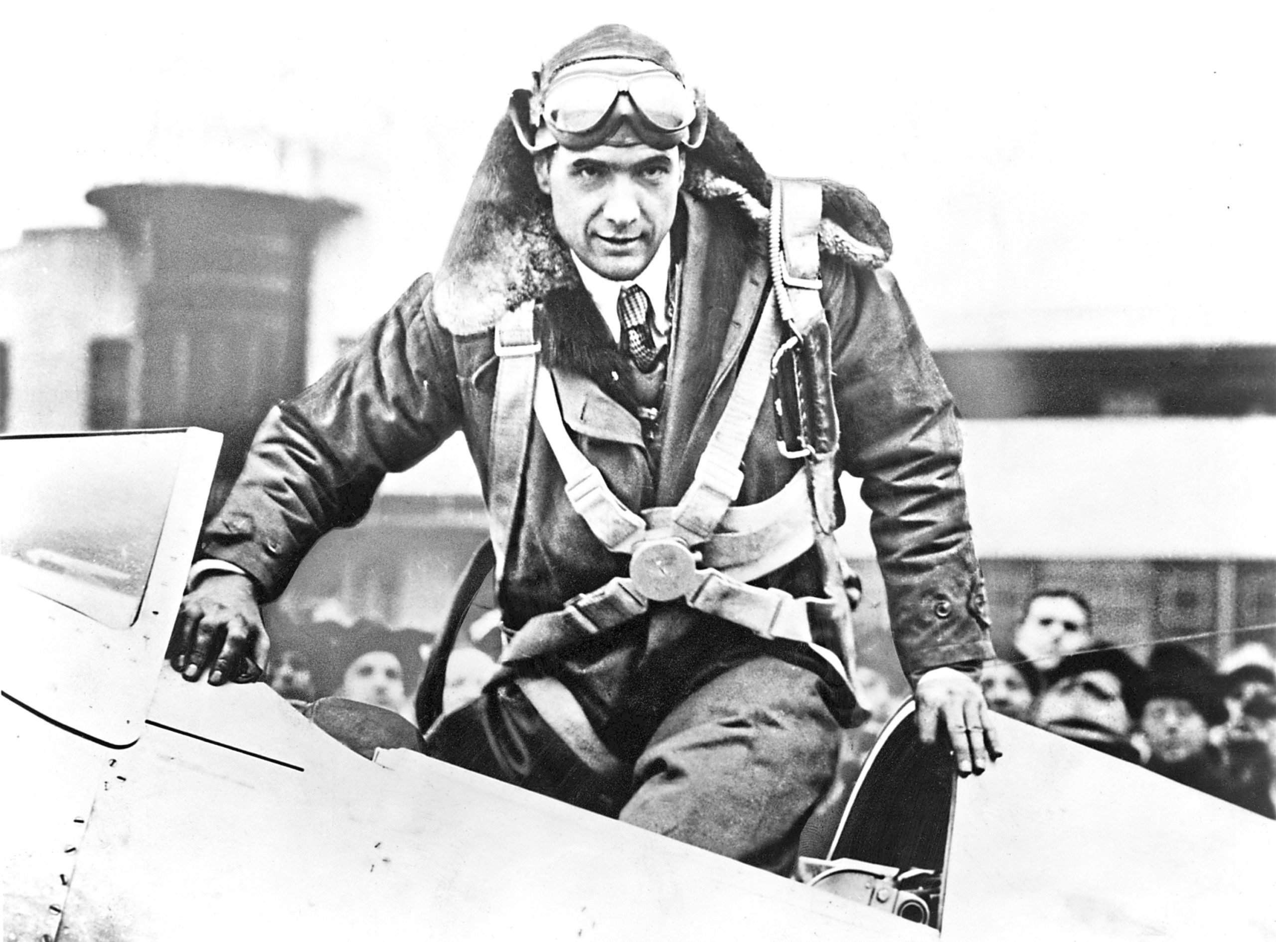 Hughes emerging from an airplane cockpit at Newark Airport