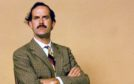 John Cleese as bungling hotelier Basil Fawlty in Fawlty Towers, as Which? reveals why holidaymakers should contact hotels directly