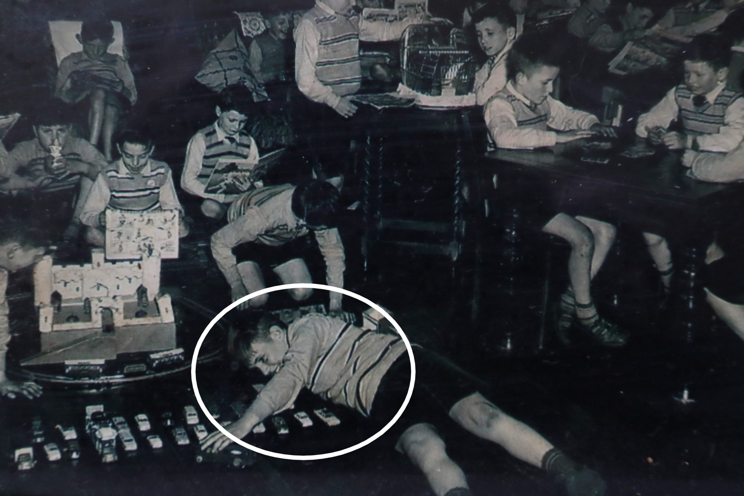 Eddie McColl's youngest brother Francis, circled, playing with                        other children at Smyllum Park orphanage where he was kept apart from siblings before his death in 1961