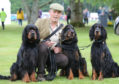 Hamish Miller with his Gordon Setters, Darcy, Bingley and Lucas
