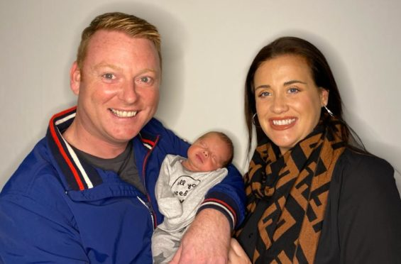 Proud mum and dad, Cherylanne and Gary, with Oliver