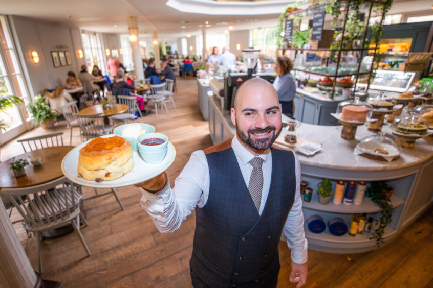 Senior supervisor Lorenzo Rinaldi delivers another supersized scone with clotted cream and jam at Gleneagles' Garden Cafe