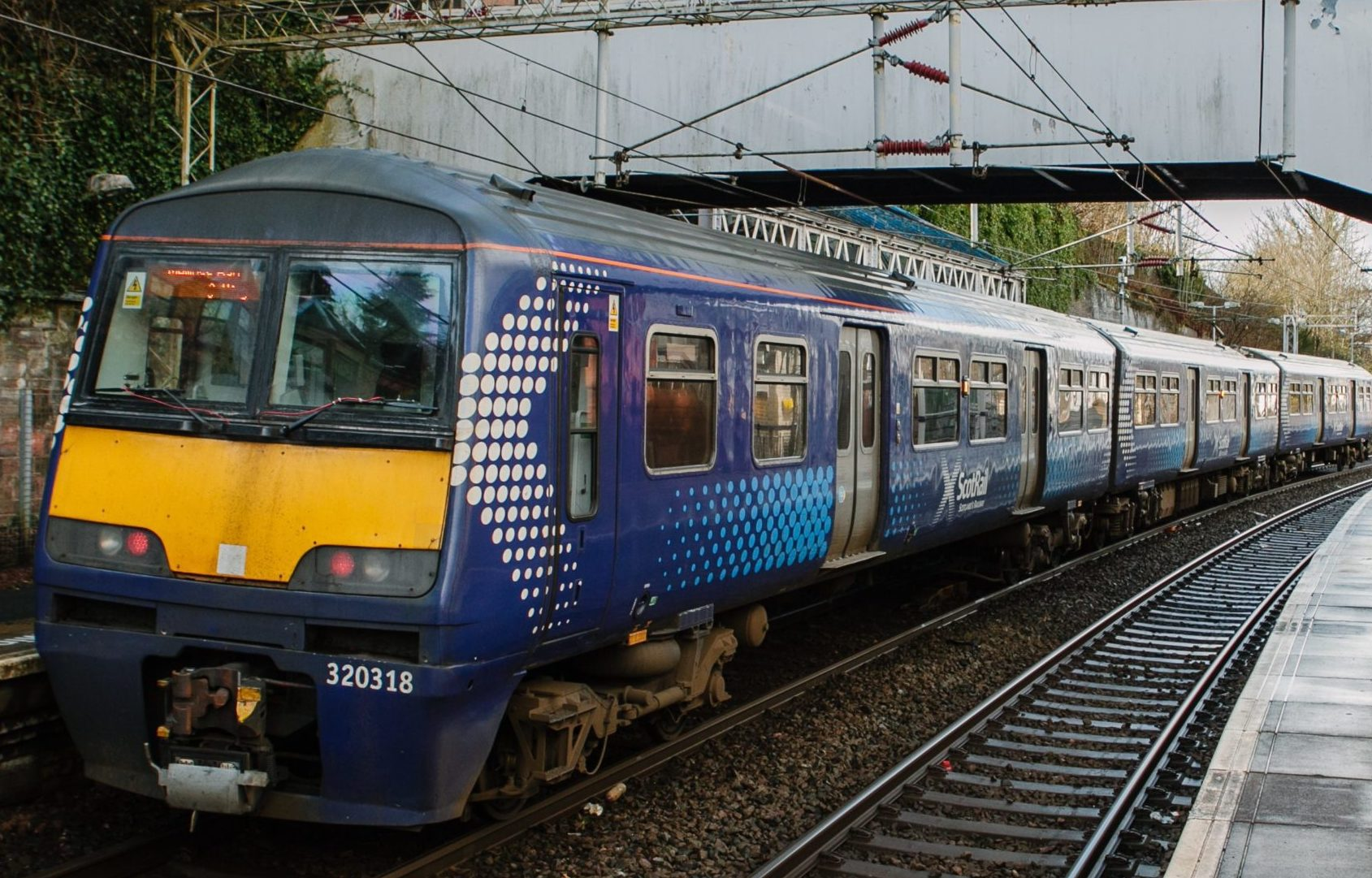 A ScotRail Class 320 train in Port Glasgow station