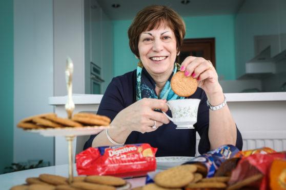 Scottish Women's Institute president and expert baker Linda Retson taste tests a reduced sugar digestive